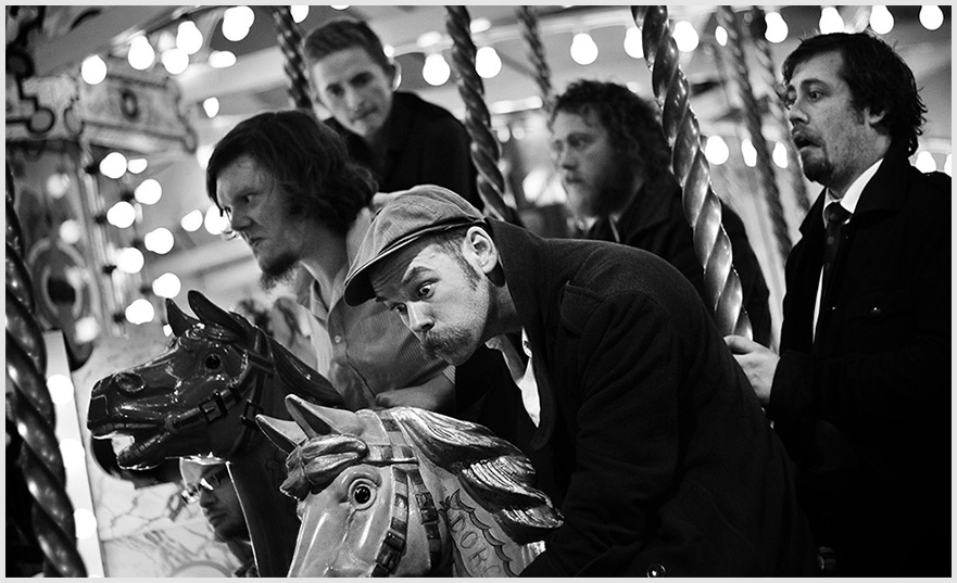 Louis Barabbas & The Bedlam Six on a fairground carousel